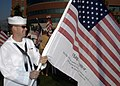 """US Navy 070909-N-5208T-002 Hospital Corpsman Seaman Apprentice Brett Olsen prepares """"Freedom Flags"""" for a two-mile """"Freedom Walk"""" in support of troops fighting the global war on terrorism.jpg"""