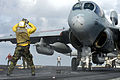 US Navy 070910-N-7883G-012 An aircraft director guides the pilot of an E-A-6B Prowler assigned to the of Electronic Attack Squadron (VAQ) 136 to a catapult aboard USS Kitty Hawk (CV 63).jpg