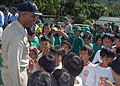 US Navy 071016-N-6710M-023 Students of Gordon Heights Elementary School greet Cmdr. Todd A. Lewis, commanding officer of the USS Tortuga (LSD 46), while conducting a community relations project in the Republic of Philippines.jpg