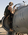 US Navy 071117-M-7404B-010 U.S. Marine Capt. Shively, left, a pilot assigned to Marine Attack Squadron (VMA) 542, enters a cockpit of an AV-8B Harrier before launching for a mission.jpg