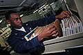 US Navy 071124-N-0167B-022 Personnel Specialist 3rd Class Cameron Casan Lino sorts through service records in the personnel office aboard the aircraft carrier USS Kitty Hawk (CV 63).jpg