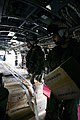 US Navy 071204-M-1226J-007 Cpl. Christopher Soper assigned to Marine Medium Helicopter Squadron (HMM) 166 (REIN), 11th Marine Expeditionary Unit (MEU) Special Operations Capable (SOC) loads food rations.jpg