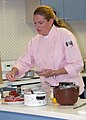 US Navy 071206-N-4918C-034 Chef Sandra Heuckroth adds spice to steaks during the cooking seminar.jpg