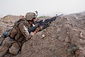 US Navy 080802-M-1341G-104 Hospitalman Apprentice Brian Rumbles, assigned to Golf Company, 2nd Battalion, 7th Marine Regiment, fires on two Taliban insurgents fleeing up a mountainside.jpg