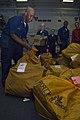 US Navy 081025-N-5253W-028 Postal Clerk 3rd Class Kevin Davis sorts bags of mail.jpg