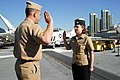 US Navy 090210-N-2565P-012 Lt. Cmdr. Robert Leopold, assigned to Pre-Commissioning Unit Makin Island (LHD 8), issues the oath of enlistment to his daughter-in-law, Personnel Specialist 3rd Class Laura Leopold.jpg