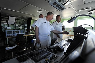 Valour-class frigate - Capt. Jimmy Schutte, commanding officer of the SAS Mendi, gives US Navy commanders a tour of the bridge the South African Navy Valour-class frigate