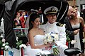 US Navy 090611-F-1942W-237 Lt. Kelly Lanning and his new wife, Megan O'Brien, enjoy a pedi cab ride following their wedding ceremony on Military Island in Times Square.jpg