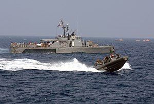 US Navy 090906-N-0120R-068 A Philippine Navy patrol boat and an 11-meter rigid hull inflatable boat operated by members of Joint Special Operations Task Force-Philippines (JSOTF-P) search for survivors Sept. 6, 2009