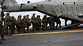US Navy 100119-N-7508R-037 Marines board a CH-53E Super Stallion helicopter aboard USS Bataan (LHD 5).jpg