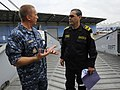 US Navy 100608-N-9643W-349 Capt. Kurt Hedberg, mission commander of Southern Partnership Station 2010, speaks with Commandant Jaimie Delgado, from the Nicaragua Volunteer Firefighters, during a tour of High Speed Vessel Swift (.jpg