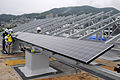 US Navy 100614-N-8335D-090 Japanese contractors install solar panels on the Public Works building roof at Fleet Activities Sasebo, Japan.jpg