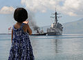US Navy 101017-N-7783B-082 A Filipino child waves as the guided-missile destroyer USS Halsey (DDG 97) gets underway after participating in Cooperat.jpg