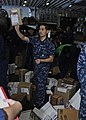 US Navy 110401-N-3154P-191 Religious Programs Specialist Seaman Andy Phan sorts and passes out mail aboard the amphibious assault ship USS Kearsarg.jpg