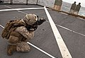 US Navy 110418-N-QP268-404 A Marine assigned to E Company the 22nd Marine Expeditionary Unit (22nd MEU), E Company fires at his target during a liv.jpg