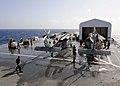 US Navy 110822-F-ET173-008 Sailors inspect a helicopter.jpg
