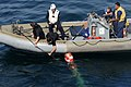 US Navy 110822-N-QL471-375 Sailors retrieve a MK-46 recoverable exercise torpedo during a weapons exercise aboard the guided-missile destroyer USS.jpg