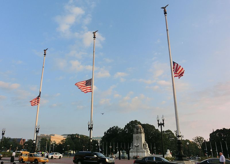In Washington, D.C., three American flags fly at half-staff on Columbus Circle (outside of Union Station) on Patriot Day 2013.