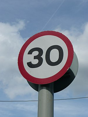 Built-up area (Highway Code) - A 30 mph speed limit reminder road sign. Used when there is insufficient street lighting for a road to legally have an automatic 30 mph speed limit.