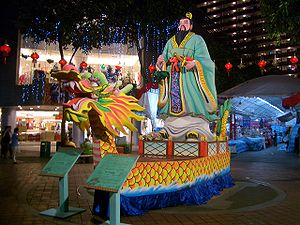 A statue of Qu Yuan in a dragon boat on one of...