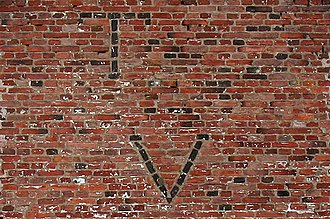 Clinker brick - Clinker bricks used to form family initials on the Jan Van Hoesen House, a 1700s Dutch house in upstate New York.