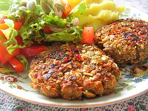 English: Vegan Pumpkin Seed-Crusted Lentil Pat...