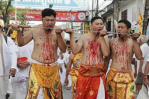 Nine Emperor Gods Festival - Tongue slashing in Phuket