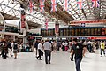 Victoria station london with bunting.JPG