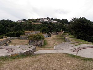 Fort George, Guernsey - View of Fort George from the preserved Clarence Battery. Luxury housing, some of which is visible above the battery, has replaced most of the old fort.