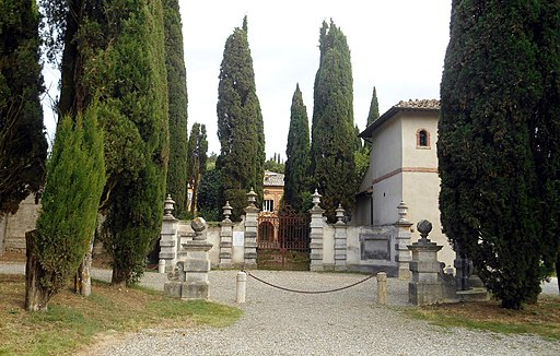Villa La Foce, entrance gate with a bunch of cypress trees