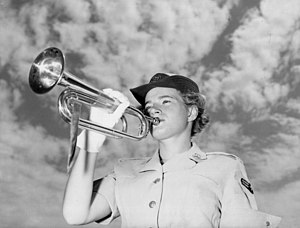 Women in the Air Force - A/2C Frances E. Courtney furnished the bugle calls of taps and reveille for the 3452nd Student Squadron (WAF) at Francis E. Warren Air Force Base in 1953