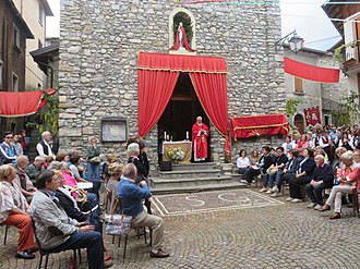 Midsummer - People prepare for a Saint John's Day procession and church service in the comune of Esino Lario, Italy.