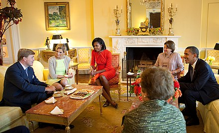 Prince Willem-Alexander and Princess Maxima meet Michelle Obama, Barack Obama and Fay Hartog-Levin at the White House in 2009. Willem-Alexander and Maxima at the White House.jpg