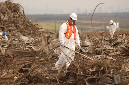 Worker combing through debris from the World Trade Center at the Fresh Kills landfill, Manhattan is visible in the distance World Trade Center wreckage-Fresh Kills landfill on Staten Island.jpg