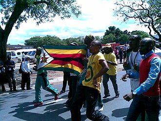 ZANU–PF - Delegates from Zimbabwe and ZANU-PF Youth League dance at the ending of the World Festival of Youth and Students in Johannesburg 2010.