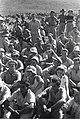 """""""להבות הבשן"""" - עלית הקיבוץ """"להבות"""" על אדמת """"חיאם אל ואליד"""" . חברי הקיבוץ העולה מקשיבים לנאומים בשעת -JNF023764.jpeg"""
