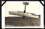 """A NOSE DIVE""- photograph of an aircraft which has landed on its nose, with a man at the right hand side of the shot, holding the wing. (7980822413).jpg"
