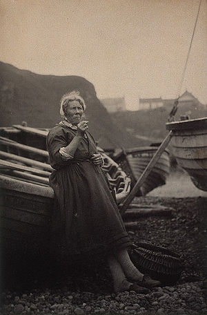 Auchmithie - Image: 'At Auchmithie 1881'. Woman leaning against boat