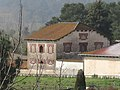 002 Granja Viader, edifici de serveis (Cardedeu), des de la via del tren.jpg
