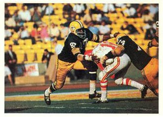 Green Bay Packers - Packers Willie Davis (left) and Henry Jordan tackling a Chiefs player in the first AFL-NFL Championship (Super Bowl I).