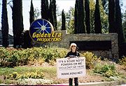 2000 protester at Gold Base with sign