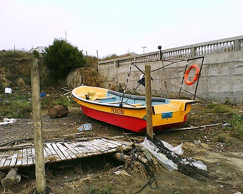 Boat after tsunami in Pichilemu.