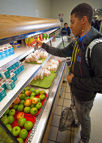 School Breakfast Program - A student at a public school in Virginia selects fruit juice for breakfast