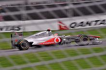 Photographie de Lewis Hamilton, à bord de la McLaren MP4-26