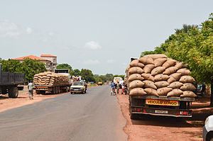 Transport in Guinea-Bissau - Trucks on a rural road in Guinea-Bissau.
