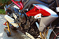 2014 Triumph Street Triple R matte graphite side closeup.JPG