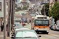 24 Divisadero trolleybus and J Church train on 30th Street, May 1997.jpg