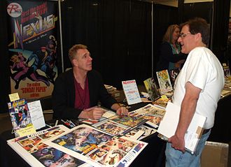 Steve Rude - Rude (left) speaking with a fan at an April 2016 comics convention