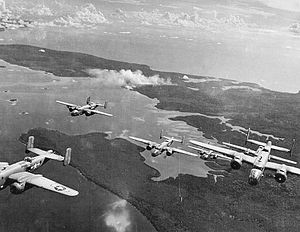 Thirteenth Air Force - B-25 Mitchells from the 42d Bombardment Group fly over Bougainville from their base at Stirling Airfield, Stirling Island, Solomon Islands, 1944