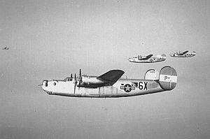 "491st Bombardment Group - Consolidated B-24Js of the 854th BS 491st BG including B-24J-1-DT 42-51255 ""255"" 6X-P- on a mission."
